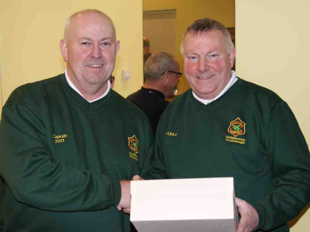 Winner of the Captain's Drive In Mattie Rice is presented with his prize by 2013 Captain Con McParland